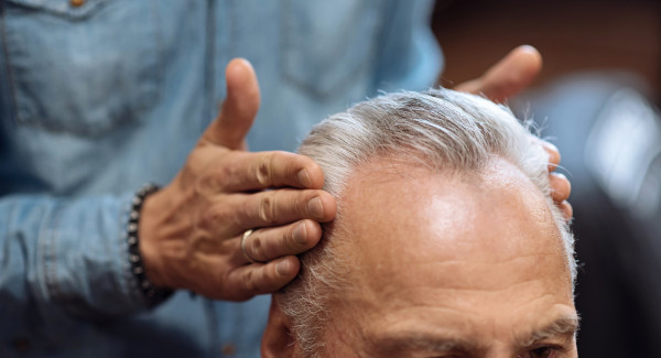 Man having hair styled